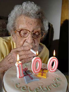 lighting-a-cigarette-off-a-100-candle-funny-old-la1_thumb[1]
